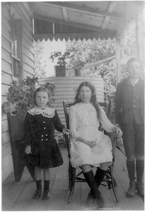 Nance's mother, Josephine Stewart, seated, on the verandah at Pine Hill c. 1917